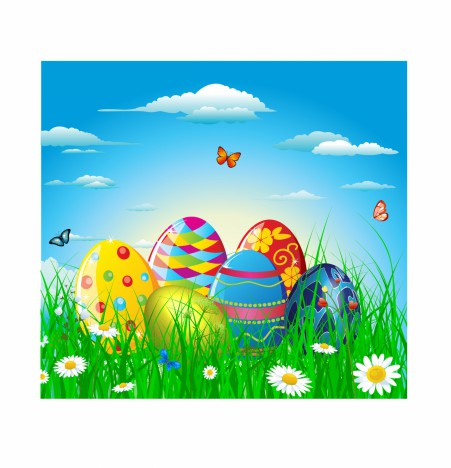 Colorful easter eggs in grass and flowers