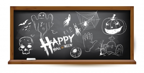 halloween hand drawing doodles on black chalkboard