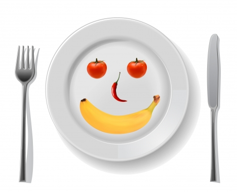 smile disk with fruit spoon fork and knife