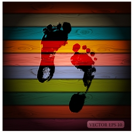 foot print on colorful wooden background